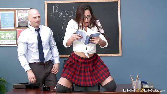 Teacher Has A Schoolgirl Read To The Class While Seated On